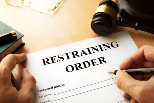 judge-signing-restraining-order